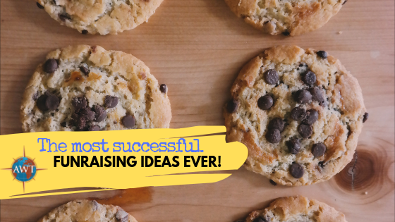 Colour photo of freshly baked cookies with a yellow banner coming from the bottom left with the AWT logo and blog title (The Most Successful Fundraising Ideas Ever!) in.