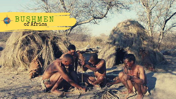 Four Bushmen of Africa using tools to create a fire outside their houses